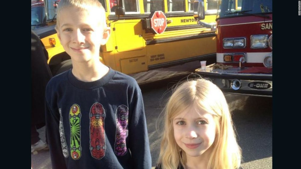 Lauren, then 6, and her brother Dalton photographed at the firehouse where they were taken after the school shooting. At that point, they didn't know anyone had been killed.