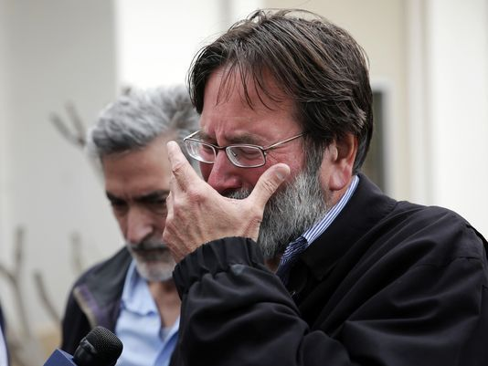Richard Martinez who says his son Christopher Martinez was killed in Friday night's mass shooting that took place in Isla Vista, Calif., breaks down as he talks to media outside the Santa Barbara County Sheriff's Headquarters on Saturday, May 24, 2014, in Santa Barbara, Calif.  (Photo: Jae C. Hong/Associated Press)