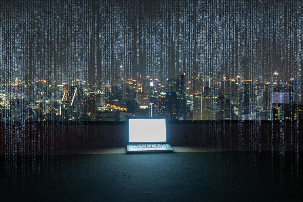 laptop against city skyline.jpg