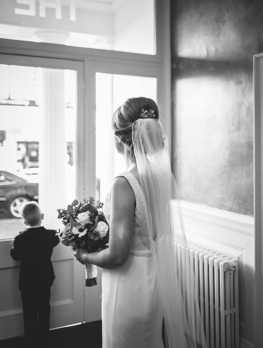 Bride waiting to leave Angel Hotel, Abergavenny