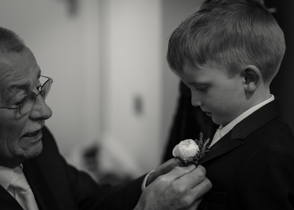 Granddad adjusting flower, Wedding