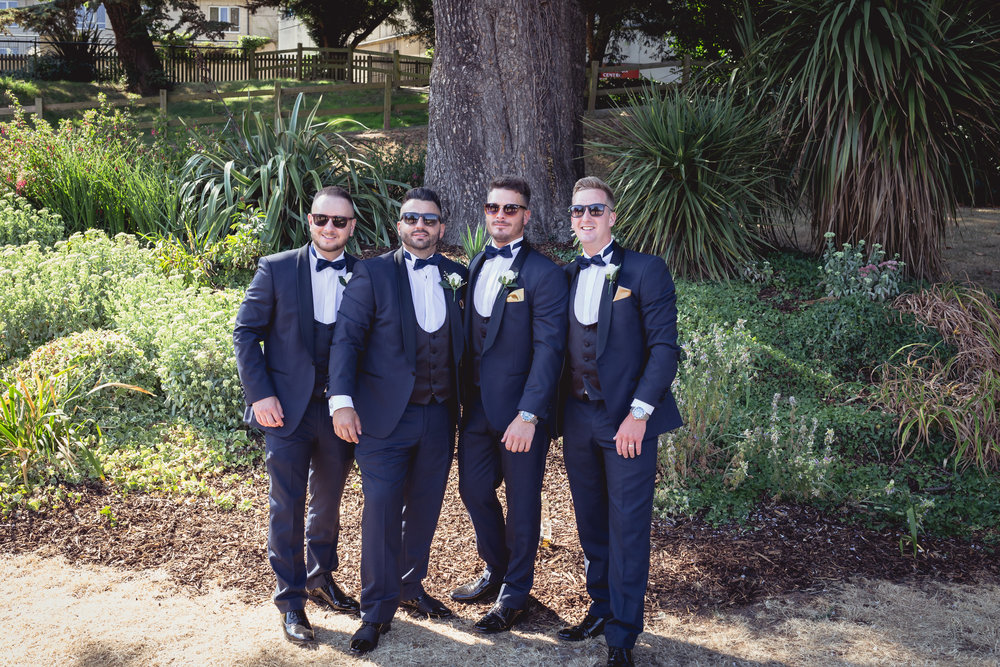 Portrait of groom and his three best men on the lawn at the Manor House, Celtic Manor Resort in South Wales