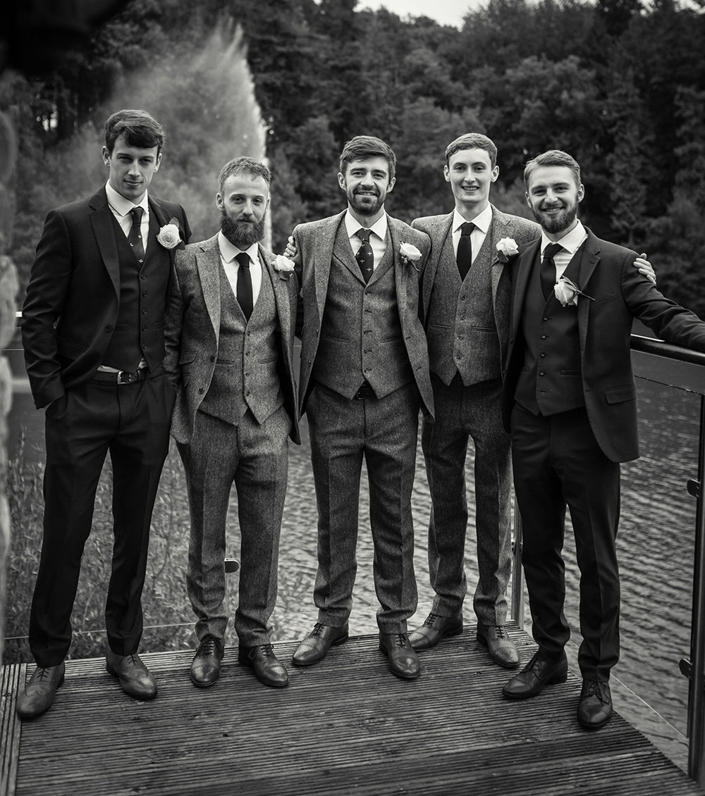 Groom with his groomsmen on the balcony at Canada Lake Lodge