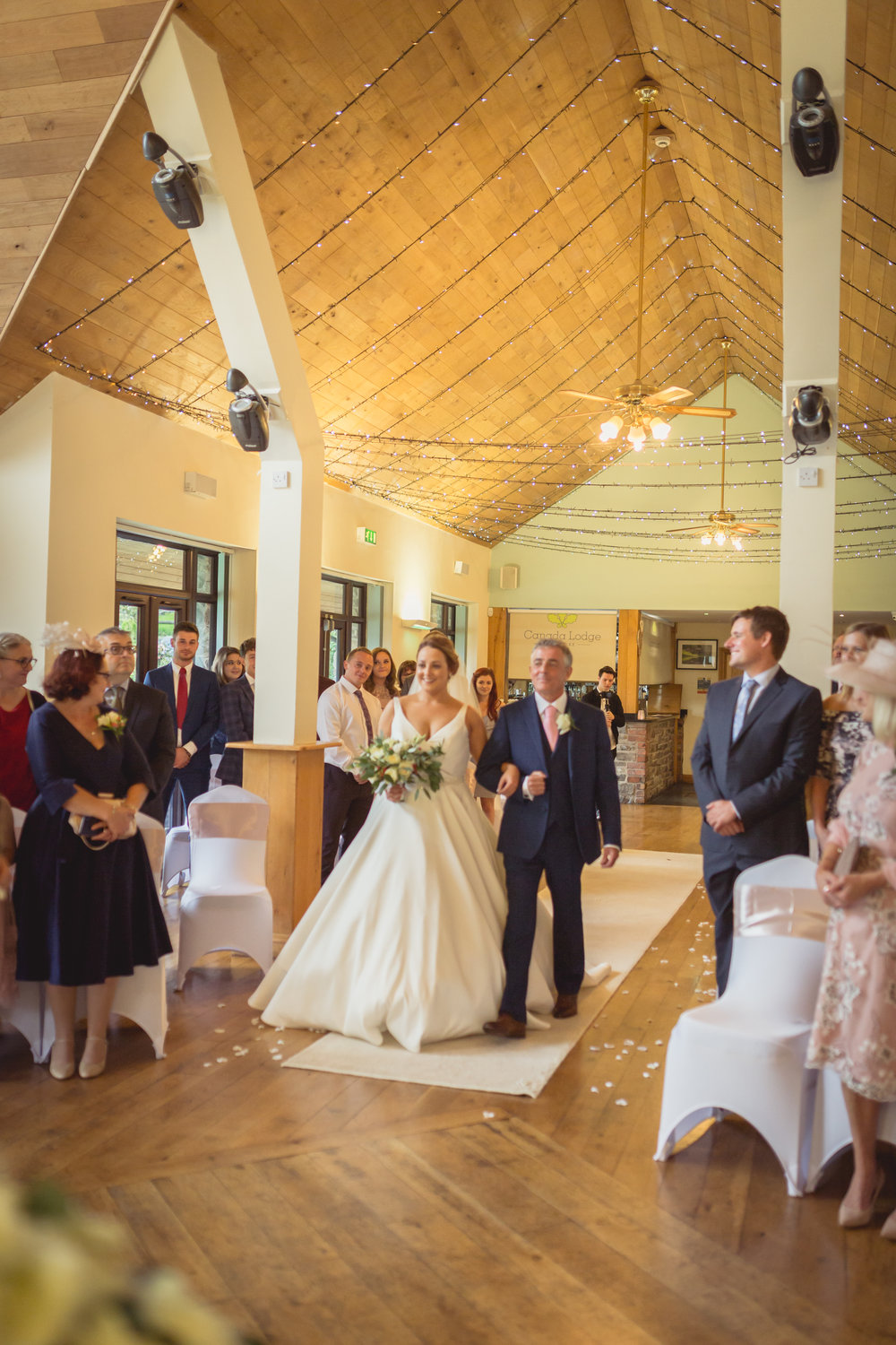 Bride and her father walking down the aisle, South Wales wedding photographer