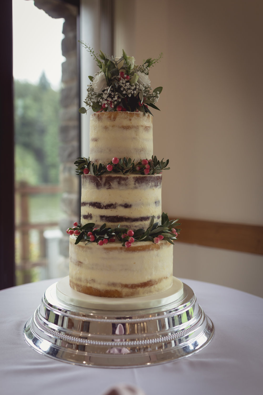 Photograph of a beautiful three tiered wedding cake