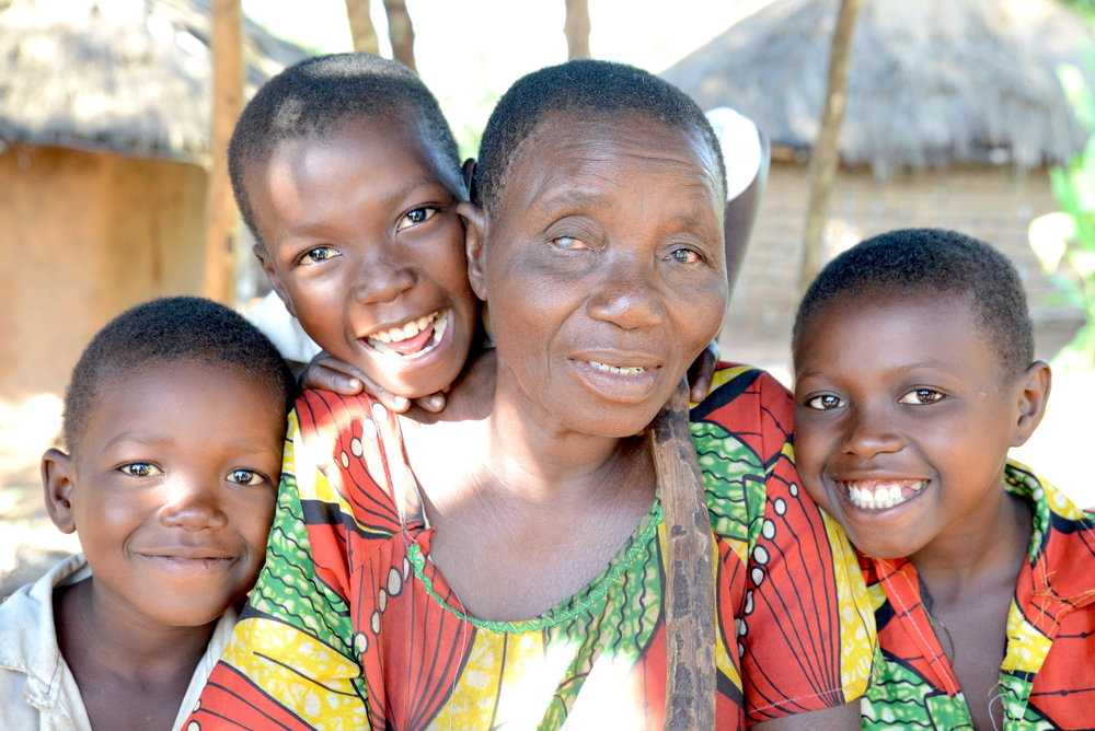 Berthine (64) is blind due to onchocerciasis. Here she's with her grandchildren: Gregoire (5), Jean (8) and Berthine (10).