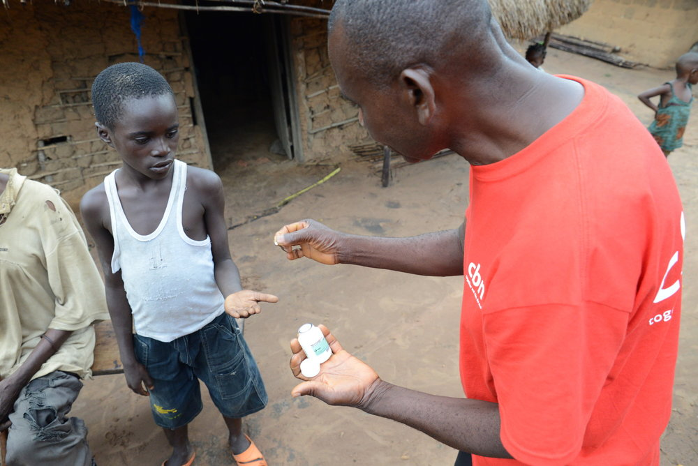CBM volunteer Theophile Ngandu in Democratic Republic of Congo helps with medical distribution to prevent river blindness