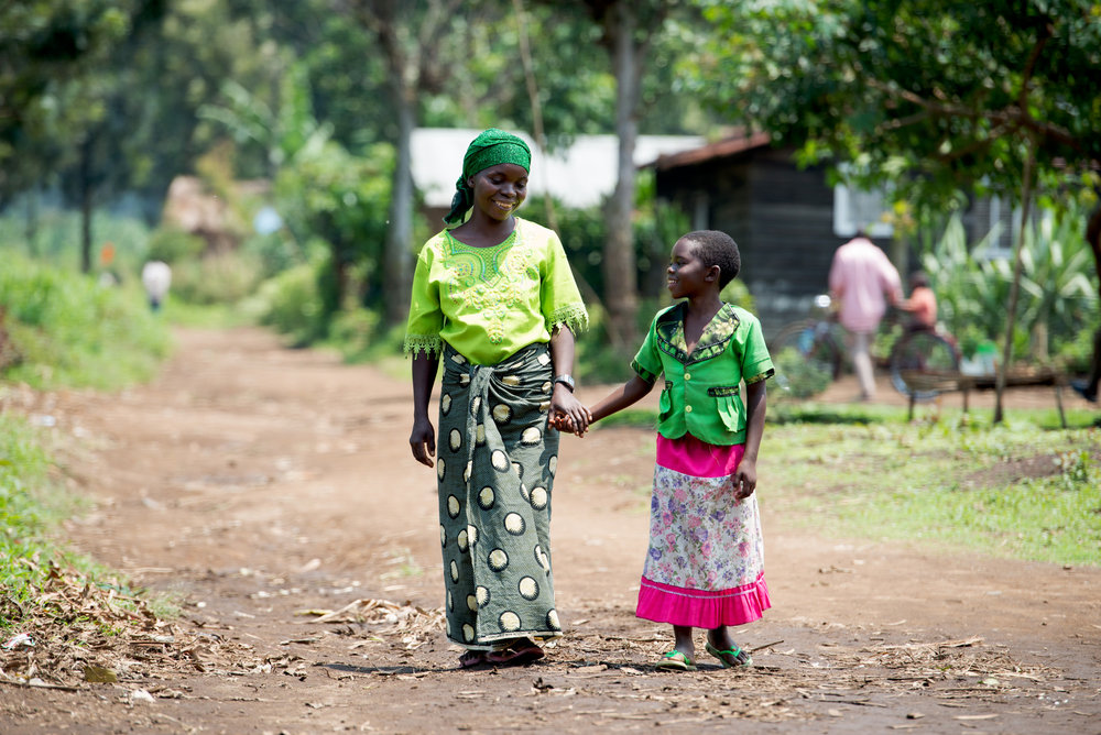 Rehema Nihibizi Nionzenga, aged 9, with her mother Esper Halera in Shasha, Democratic Republic of Congo. A Gift in your Will could help another child like Rehema.