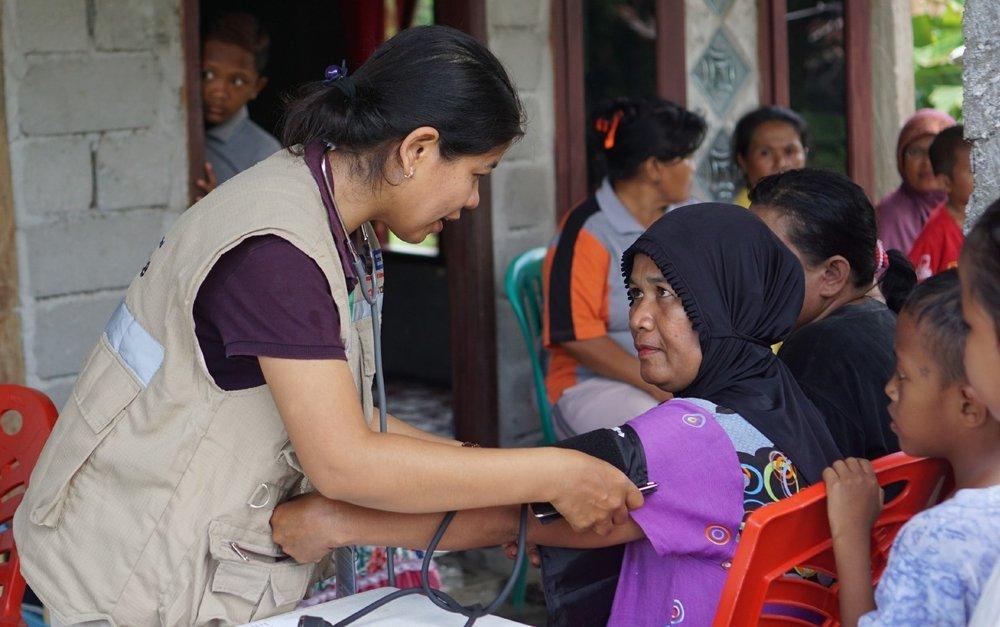 CBM-YEU providing medical care and assistance to victims of the earthquake and tsunami