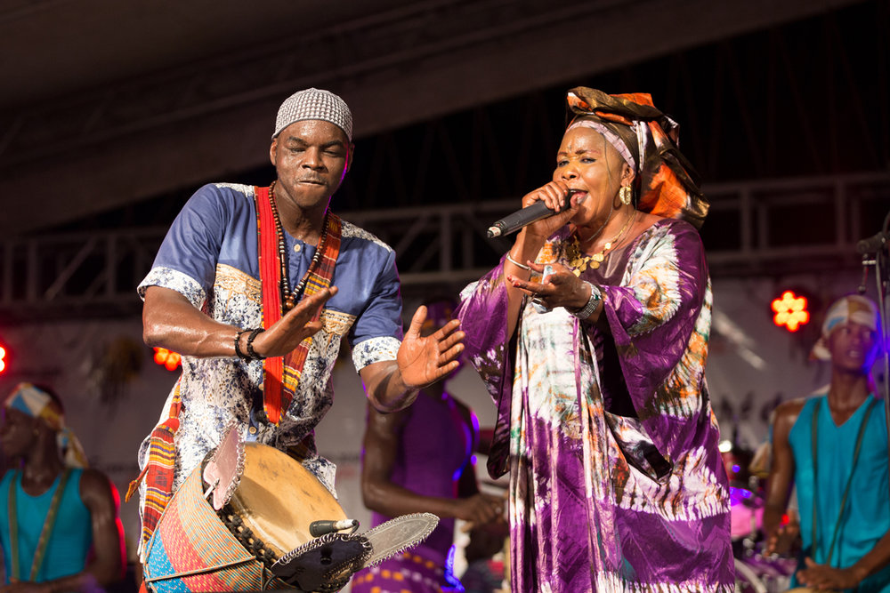 Bendia leader Baba Toure on djembe, and Mamou Kone, a Malian griot on vocals. The Abidjan based dance troupe draws on the dynamic urban culture found in Abidjan, expressive of the multitude of ethnic traditions present in the city.