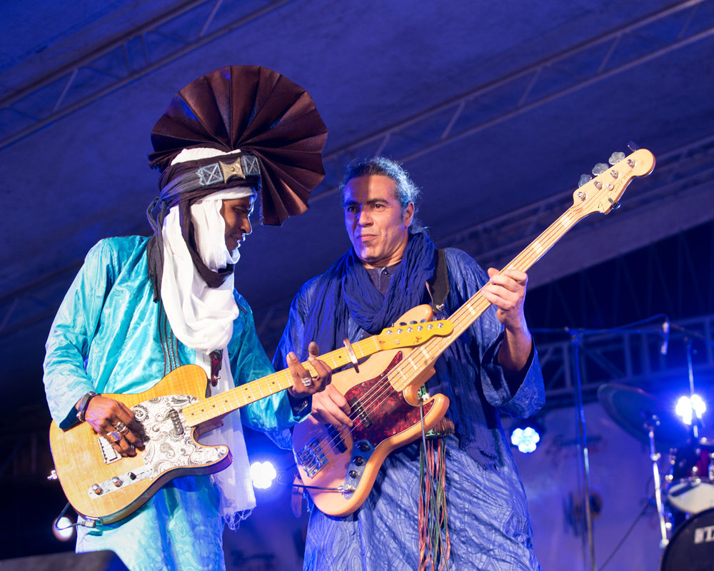 Ezza, a Tuareg bass, drums, guitar power trio in the blues rock vein, fronted by Omar Adam Goumour the guitarist from Niger. The band came together in France where Goumour met Algerian bassist Menad Moussaoui and drummer Stéphane Gratteau.