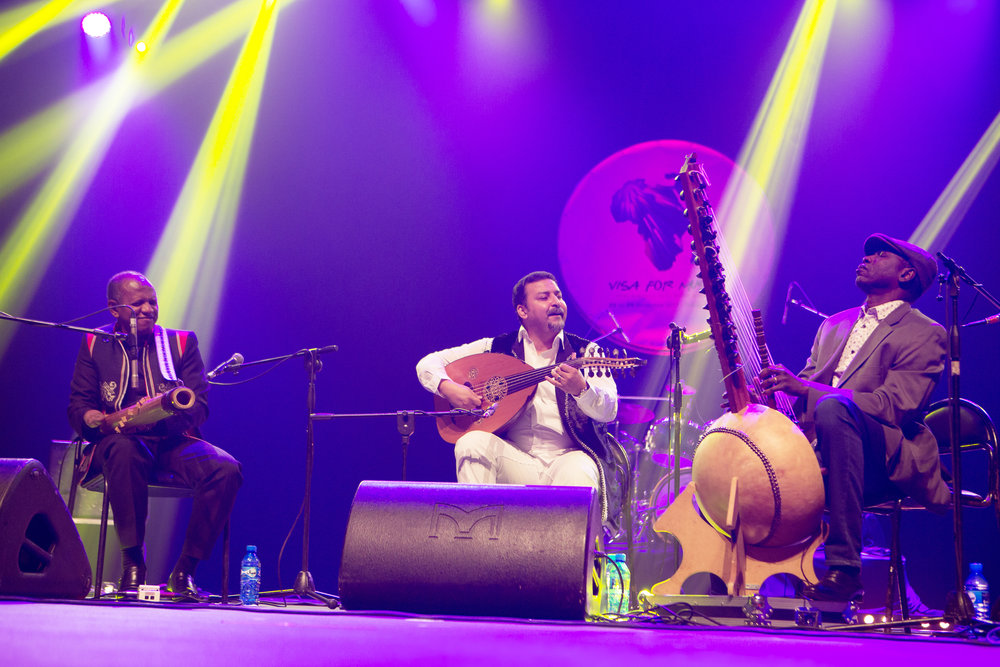 (L-R) Rajery of Madagascar on valiha, performing in the 3MA string trio along with Driss Maloumi of Morocco on oud, and Ballaké Sissoko of Mali on kora at the 2017 Visa For Music festival. 3MA willbe in New York March 15th at City Winery. Click on the photo to continue the photo gallery of performances.