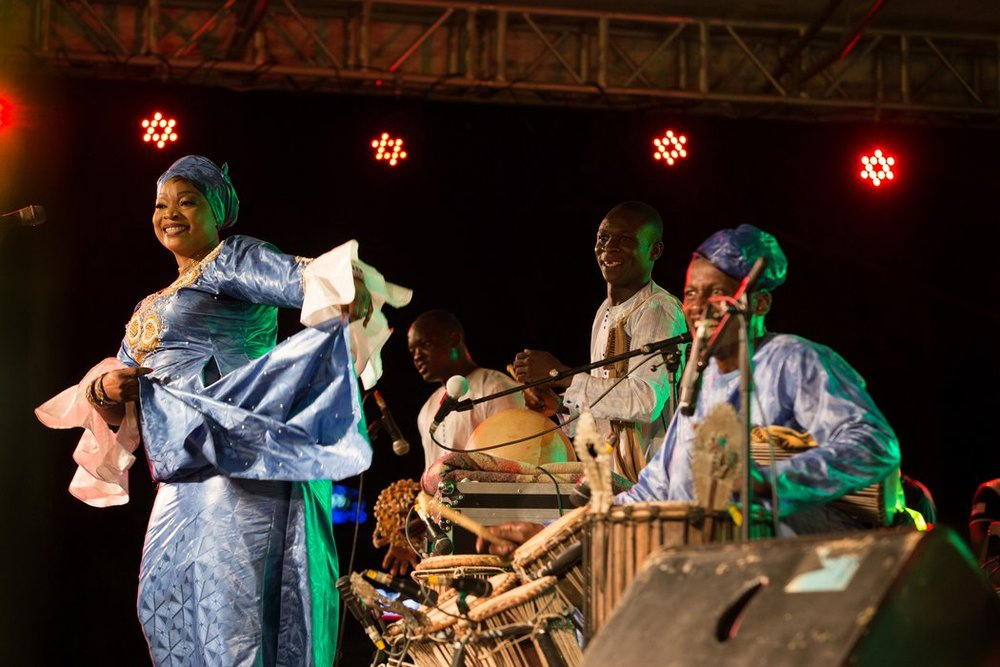 Cheickne Bengue Sissoko, Yah Kouate, Assaba Dramé on djeli n'goni, Amadou Keita on balafon, Youssef Koné on calabash and tamen, and Ousmane Boya on Yabara of the Somane 5 Tamens group at MASA, Abidjan, Cote d'Ivoire