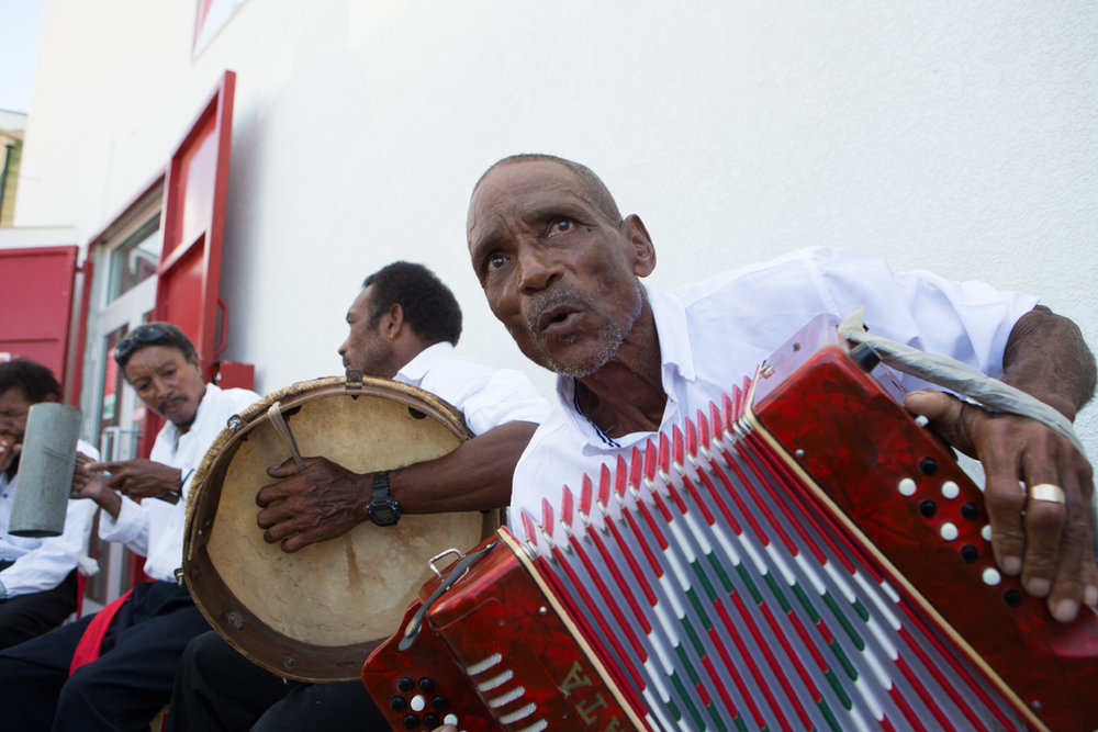 Isma Alie, a beloved jing ping artist on Creole Day in Dominica celebrated by street performances and traditional Creole attire in Roseau Dominica, October 26th.