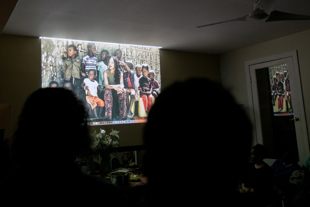 Natu and Guinean kids. Projected photo by Jamie Ambler