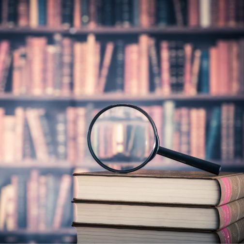 books-and-magnifying-glass-picture-id519427336.jpg
