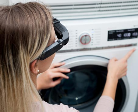 picture of woman wearing NuEyes Easy Smartglasses for Low Vision