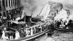 The  Kenosha  rescuing survivors off the capsized  Eastland . Image from the Chicago Tribune.