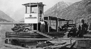 Clara Goddard in front of the  A.J. Goddard  on the shores of Lake Bennett. Image from the Yukon Register of Historic Places.