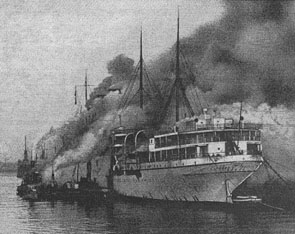 The RMS  Empress of Scotland  on fire at the scrapyard.