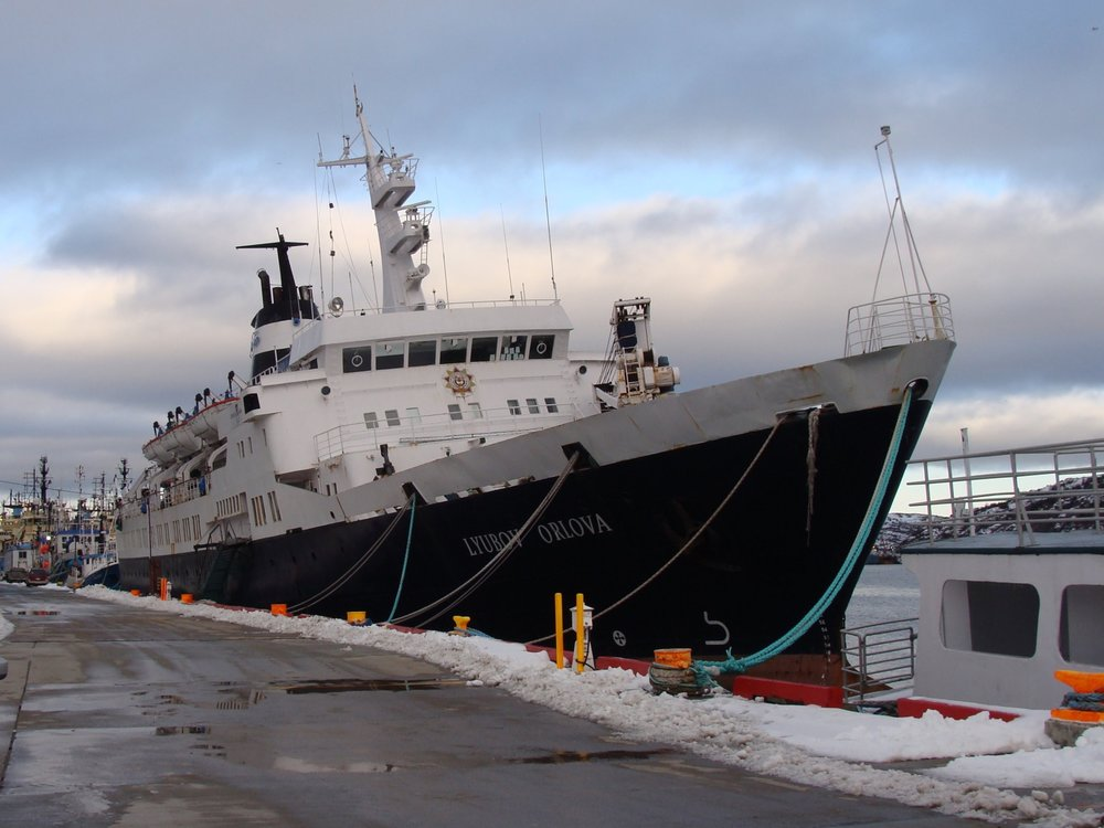 The  Lyubov Orlova,  listing to starboard in the harbour. Image by Heather Elliott, December 2011.
