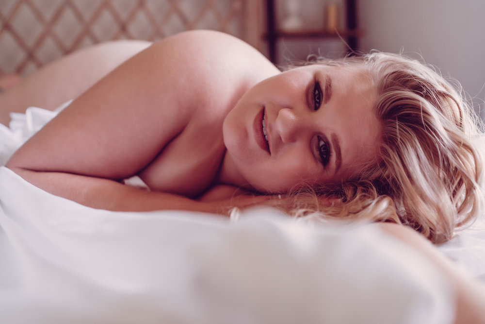 Oklahoma City Boudoir Session woman lying on bed