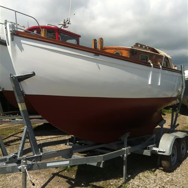 MYTHICAL awaiting the new mast and sail installation before returning to the sea with her proud owner