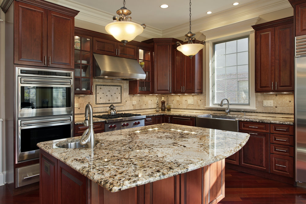 modern kitchen - This kitchen features granite countertops and cherry cabinetry.