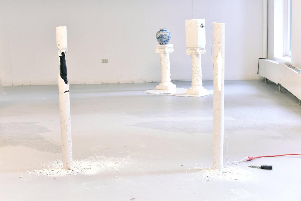 pilars  plaster, hand lathed wood leg, florescent light, extension cord, chisel (2015)
