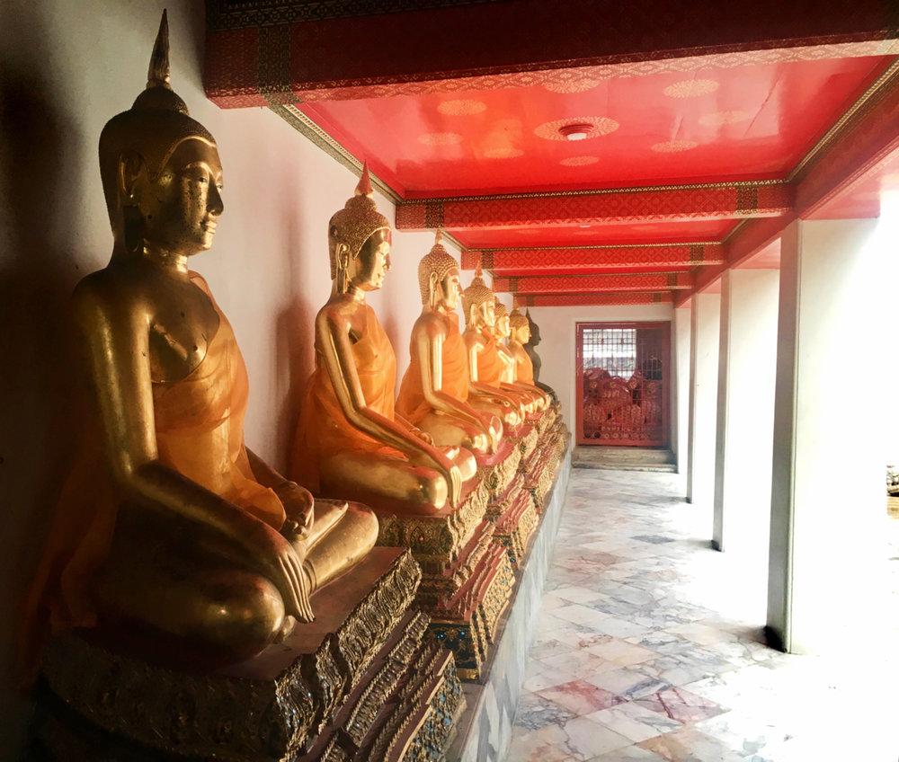 Several gold Buddha images at the Wat Pho temple in Bangkok