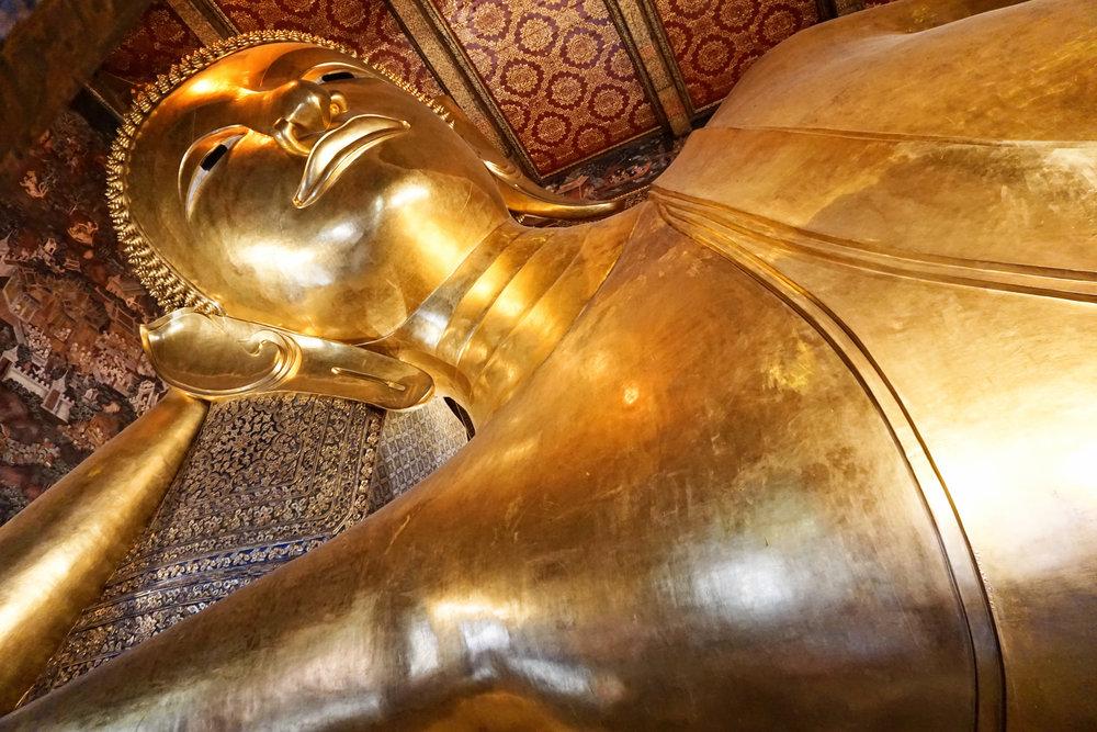 Front view of large reclining Buddha in Bangkok