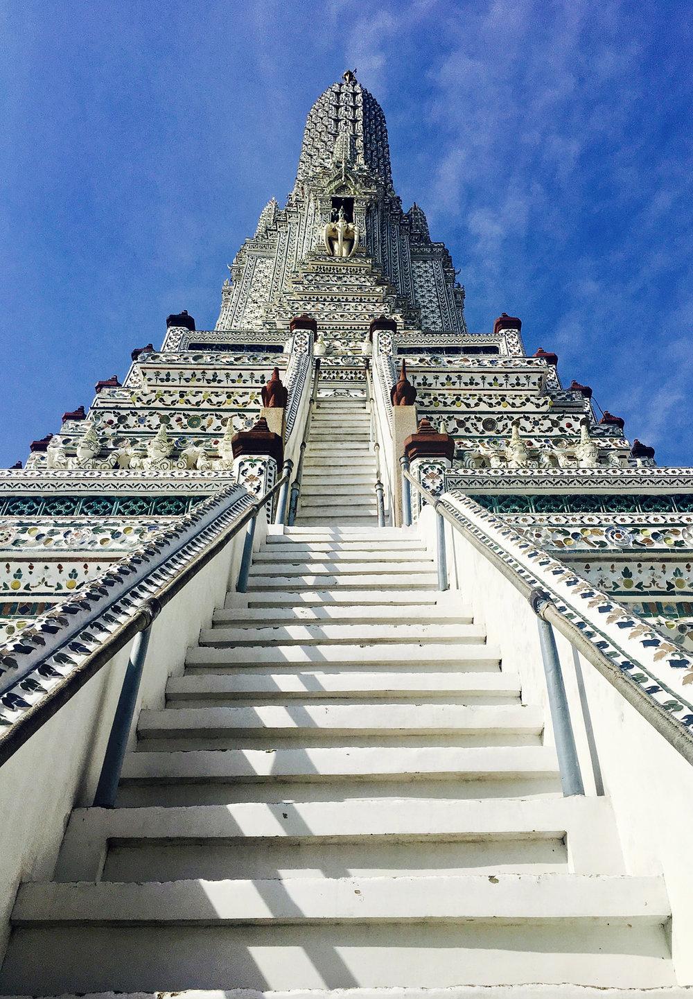Upward view of Wat Arun showing the stairs