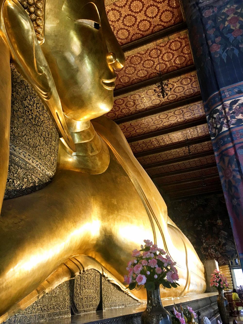Side view of large reclining Buddha in Bangkok