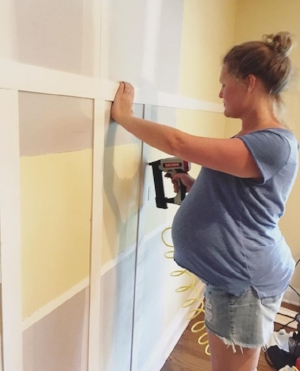 8 1/2 months pregnant, adding board and batten to the dining room!