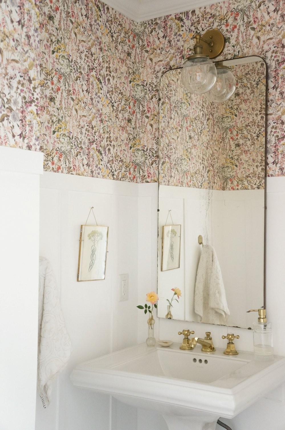 The Liberty of London Wallpaper in our powder room is so feminine and cheerful - it makes me think of Summer all year round.