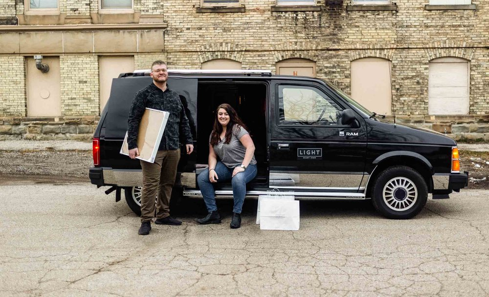 Owners of Light Gallery + Studio Matthew Provoast and Erika Townsley delivering artwork in their vintage van.