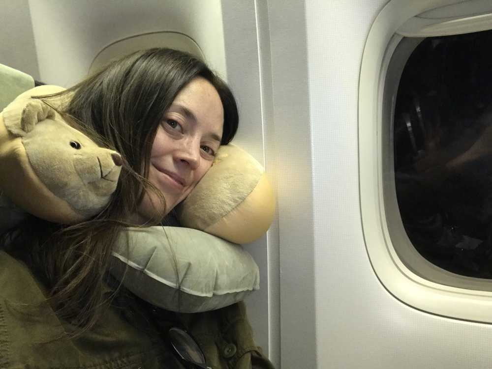 """My """"double-decker"""" neck pillow technique, for long overnight flights in economy. It really works!"""