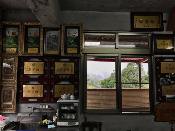 A corner of Bai's tasting room, with a window looking out to the gardens.