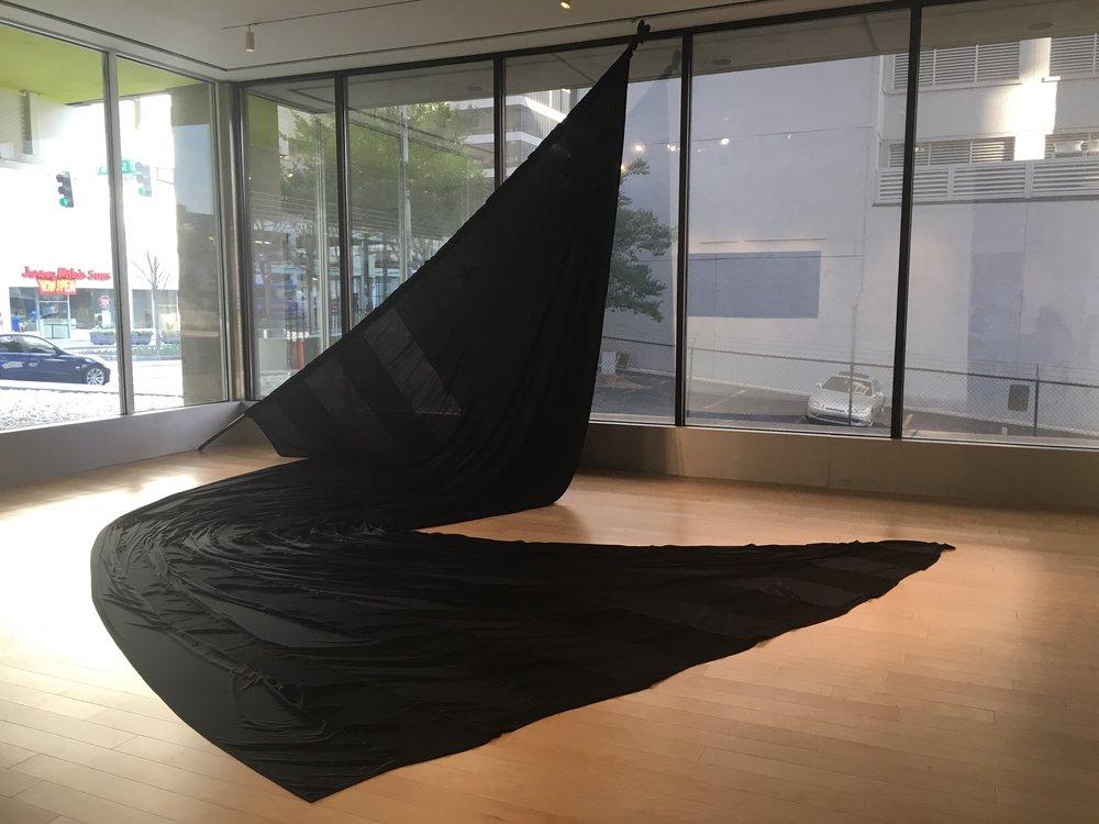Paul Stephen Benjamin, Black Cotton Flag Made in Georgia , 2018, Black Cotton, 14'x27'. Courtesy of the artist.