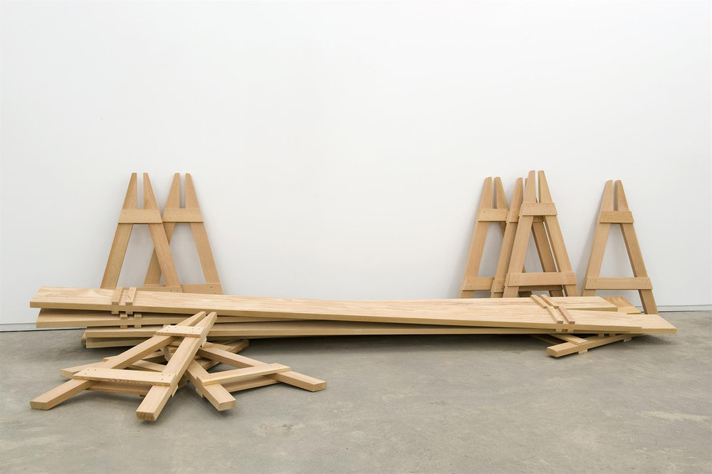 Brian Jungen,  Barricades , 2010 Fir, 5 parts, each 41 x 26 x 144 inches (104 x 66 x 366 cm). Courtesy Catriona Jeffries.