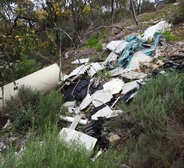- Rubbish dumped over the edge of Mount Bold Road