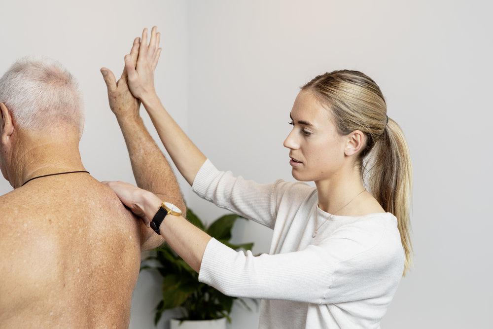 Physiotherapist Jacqui McDougall treating shoulder injury