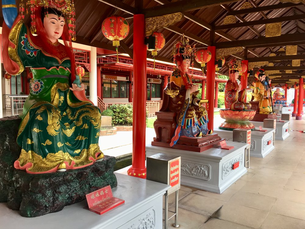 Chinese style buddha images at City Pillar Shrine in Suphan Buri