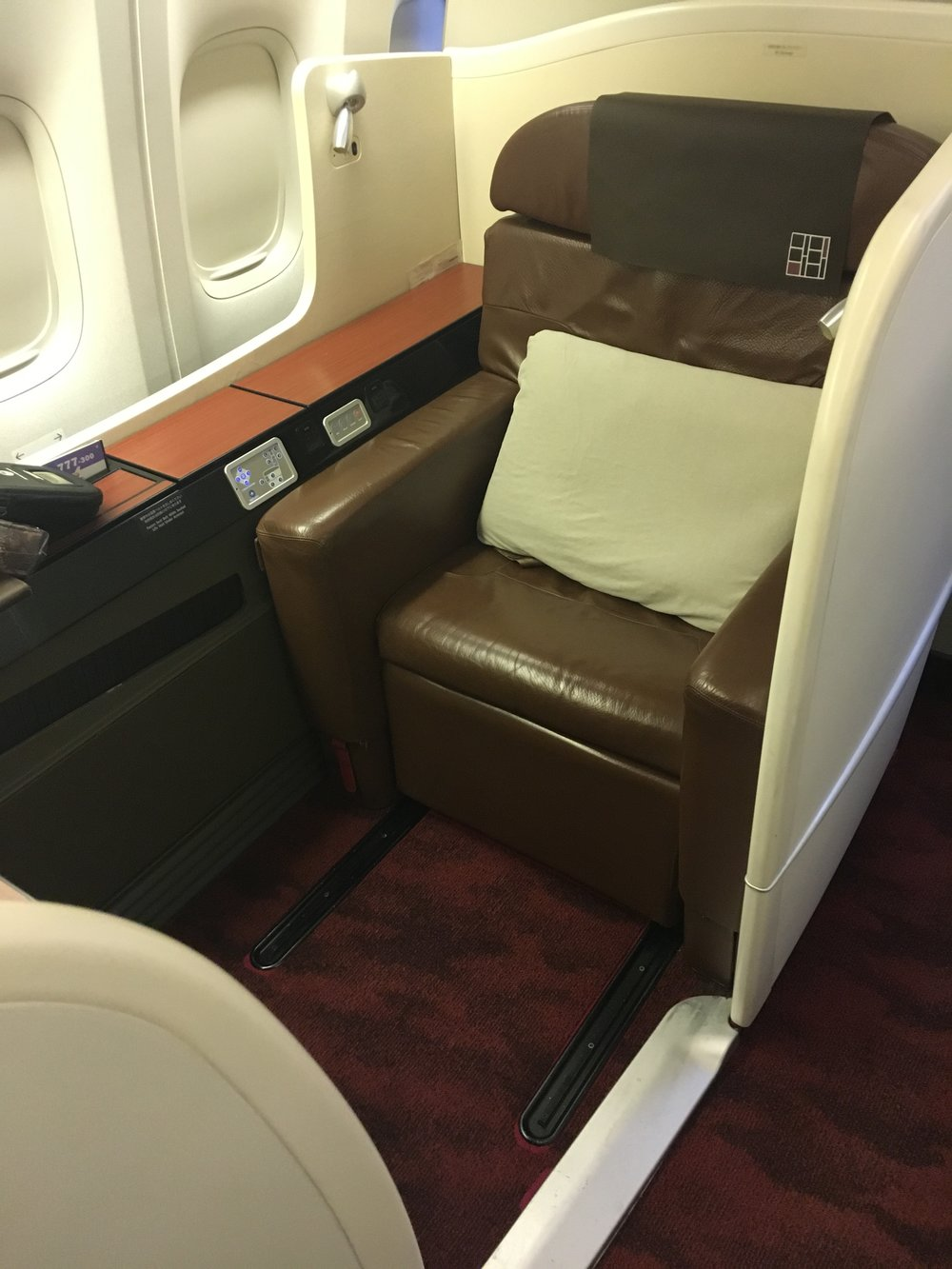 "Super comfy ""arm chair"" style lie-flat recliner in JAL First Class. Loads of storage compartments everywhere too which was nice."