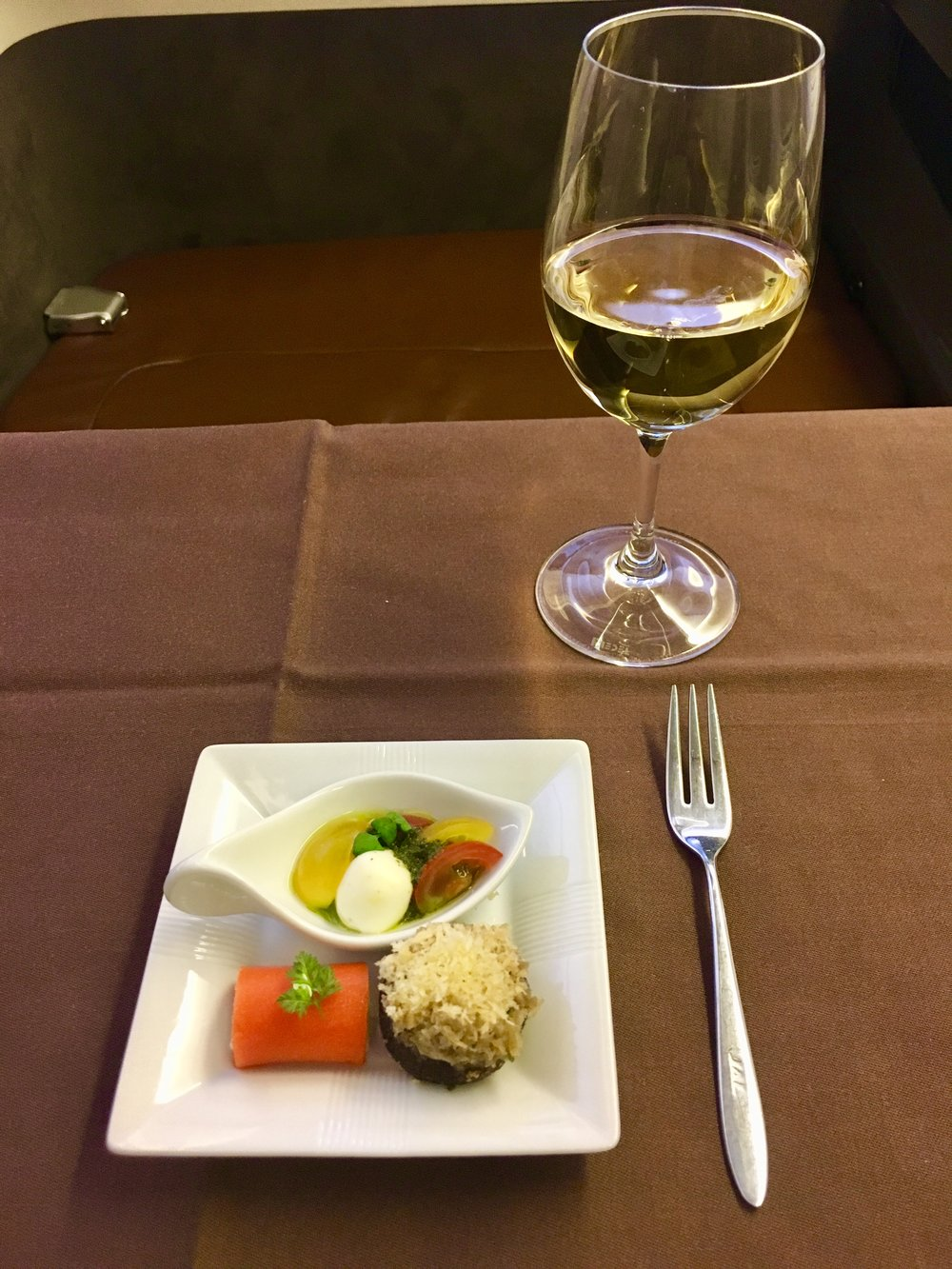 When flying in First Class, it's basically compulsory to drink champagne…especially on JAL where they offer Cristal (2009 Louis Roederer Cristal to be precise) which retails for about $250 a bottle on the ground. The amuses bouches were nice, too