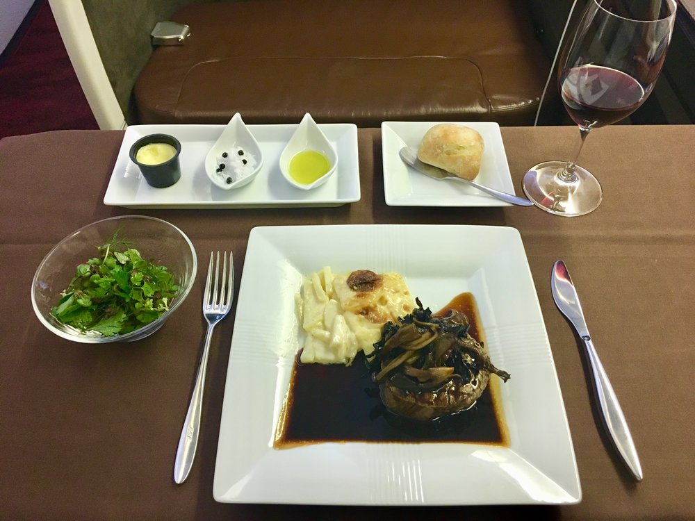 The presentation was a bit lacking but this Wagyu beef filet with mushrooms and potatoes Dauphinoise was stellar. Paired with a nice 2013 Burgundy…near perfection for a meal on a plane. This may be the tastiest thing I've ever eaten in the air (neck and neck with another Wagyu beef dish in business earlier in the year).