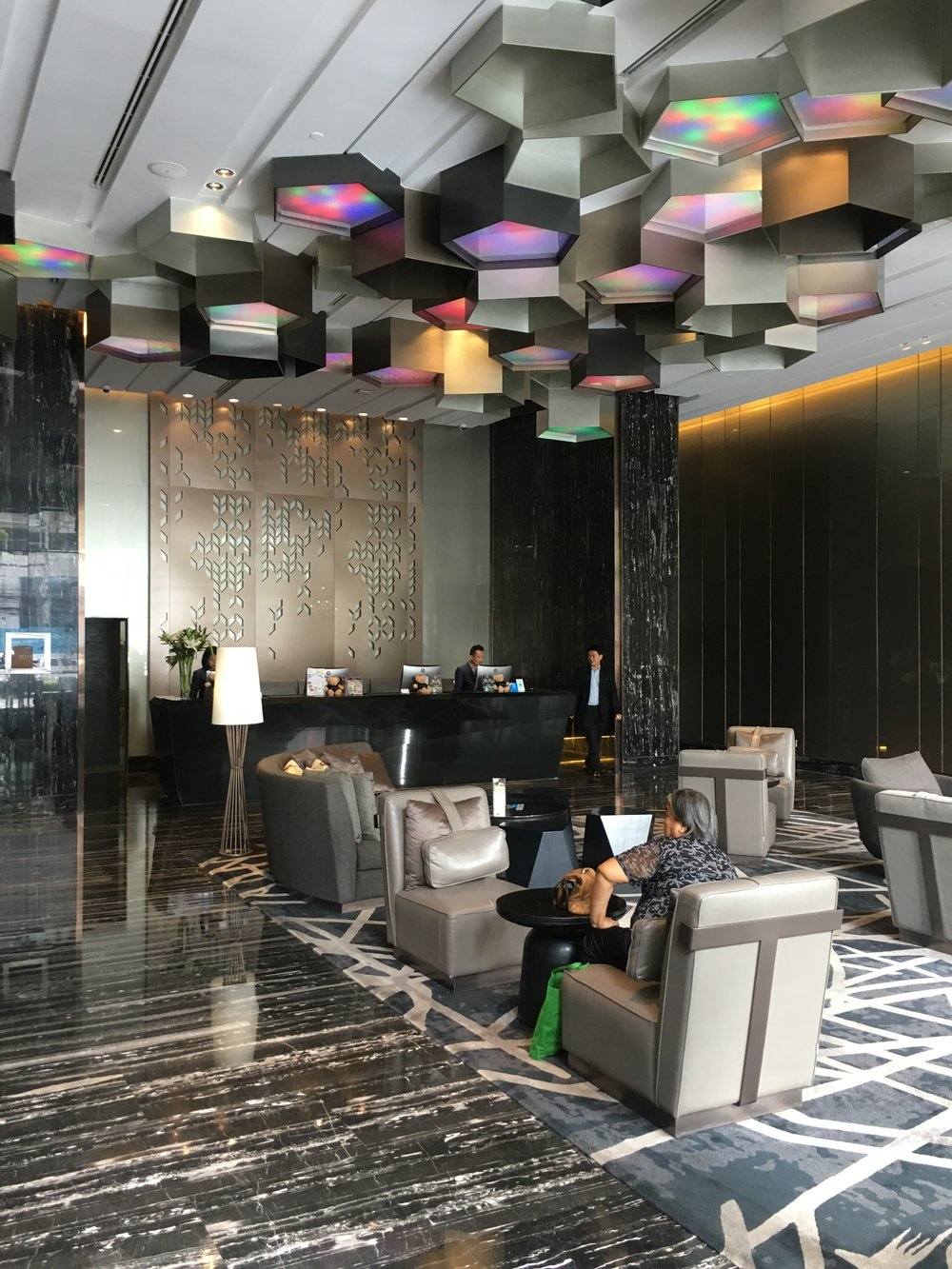 A trendy and inviting lobby welcomes you to the Compass Skyview Hotel