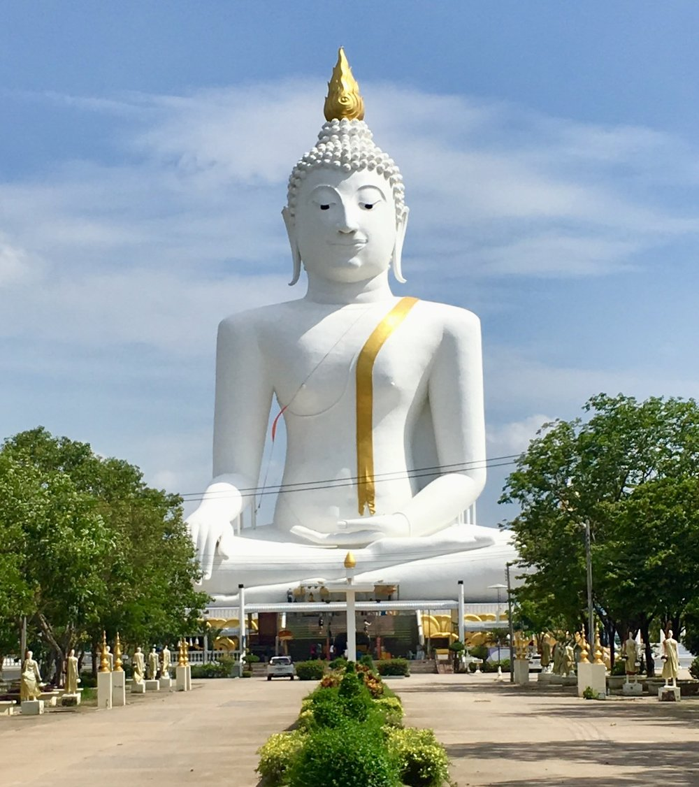 """It's not all scary at the massive Wat Phai Rong Wua temple complex, there's an area focusing on """"heaven"""", too, as well as this huge white Buddha image overlooking the entire place"""