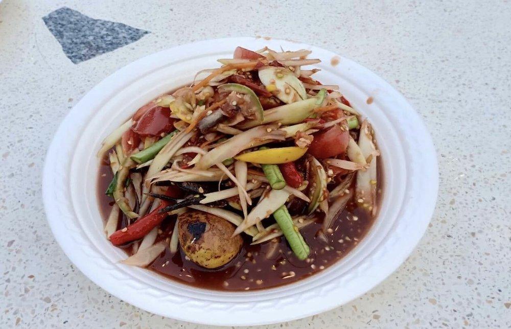 Tam Poo Bphaa Ra: spicy green papaya salad with salted crab mixed in pla ra (pickled fish)