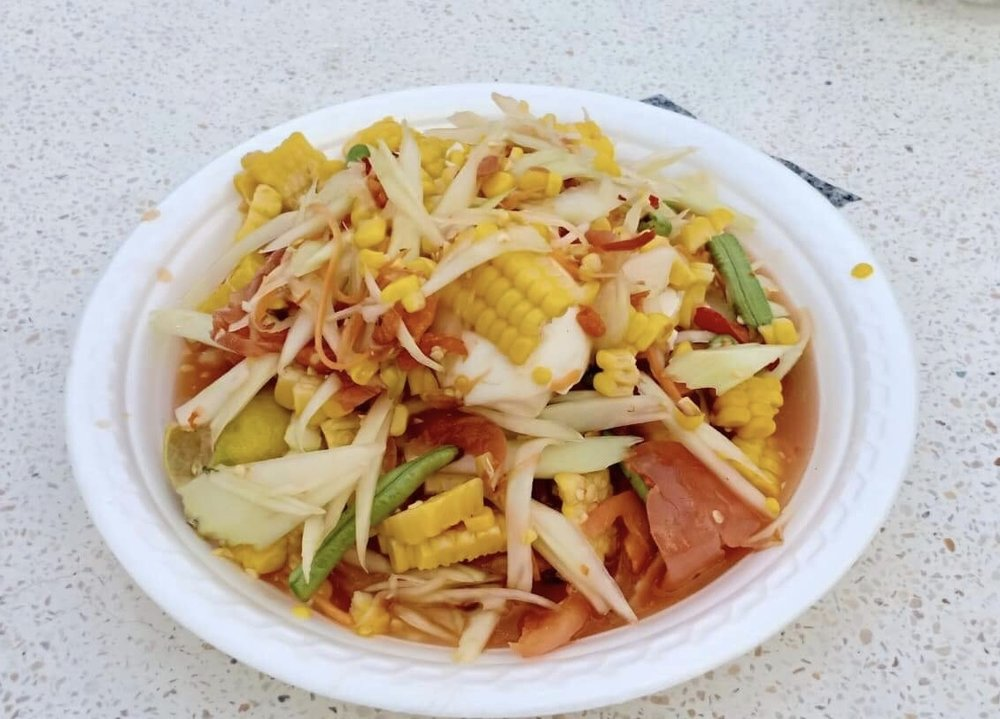 Tam Khao Phod: spicy sweet corn green papaya salad with salted eggs